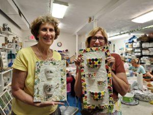 student mosaic art class pottery project